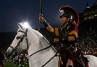 25 November 2006: Tommy Trojan & Traveler enter the field at the start of the NCAA College Football final home game of the season for the University of Southern California USC Trojans with a 44-24 victory over the University of Notre Dame Irish at the LA Memorial Coliseum. USC moved up to the second spot in the BCS Poll with this win over ND.<br />