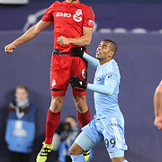 NEW YORK, NEW YORK - November 06:  Nick Hagglund #6 of Toronto FC is challenged by Tony Taylor #99 of New York City FC during the NYCFC Vs Toronto FC MLS playoff game at Yankee Stadium on November 06, 2016 in New York City. (Photo by Tim Clayton/Corbis via Getty Images)