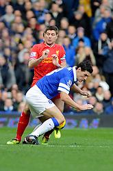 Liverpool's Steven Gerrard challenges Everton's Gareth Barry - Photo mandatory by-line: Dougie Allward/JMP - Tel: Mobile: 07966 386802 23/11/2013 - SPORT - Football - Liverpool - Merseyside derby - Goodison Park - Everton v Liverpool - Barclays Premier League