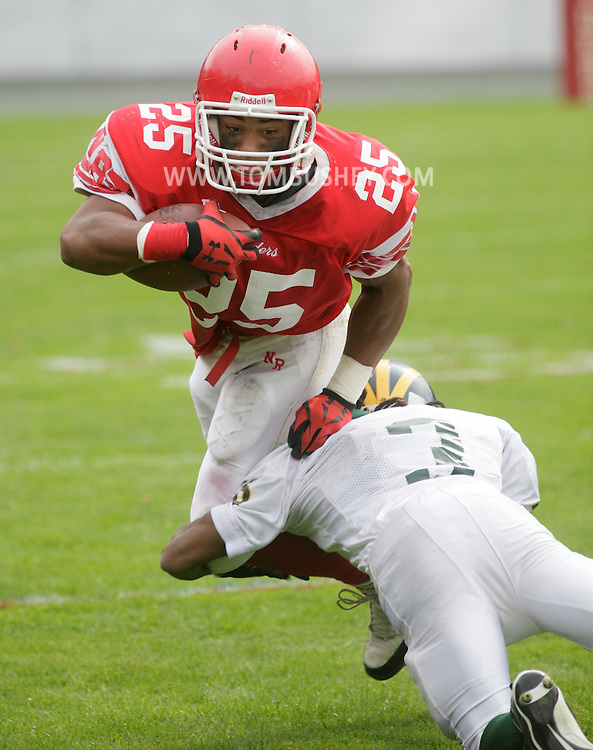 Thiells, New York -A North Rockland running back is tackled by a Ramapo defender during a high school football  game on Sept. 26, 2009.