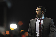 Newport county manager Justin Edinburgh walks off the field at the end of the match which his side lost 1-2. Skybet football league 2 match, Newport county v AFC Wimbledon at Rodney Parade in Newport, South Wales on Tuesday 25th Feb 2014.<br /> pic by Andrew Orchard, Andrew Orchard sports photography.