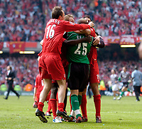 Photo: Daniel Hambury.<br />Liverpool v West Ham United. The FA Cup Final. 13/05/2006.<br />Liverpool's players mob goal keeper Jose Reina after his penalty saves wins them the FA Cup.