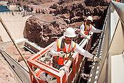 19 AUGUST 2010 --  HOOVER DAM, AZ: Gus Gomez and Arturo Caro (L to R) work on the Hoover Dame bypass bridge. Construction work is continuing on the Hoover Dam bypass bridge. The Colorado River Bridge is the central portion of the Hoover Dam Bypass Project. Construction on the nearly 2,000 foot long bridge began in late January 2005 and the completion of the entire Hoover Dam Bypass Project is expected in late 2010.  When completed, this signature bridge will span the Black Canyon (about 1,500 feet south of the Hoover Dam), connecting the Arizona and Nevada Approach highways nearly 900-feet above the Colorado River.  PHOTO BY JACK KURTZ