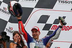 © Licensed to London News Pictures. 20/10/2012. Jorge Lorenzo (SPA) riding for the Yamaha Factory Racing celebrates after winning during the Race day of the round 16 2013 Tissot Australian Moto GP at the  Phillip Island Grand Prix Circuit Victoria, Australia. Photo credit : Asanka Brendon Ratnayake/LNP