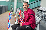Michael Smith (#2) of Heart of Midlothian FC poses with the Betfred Scottish Football League Cup, ahead of the quarter-final match against Aberdeen, at Oriam Sports Performance Centre, Heriot Watt University, Edinburgh Scotland on 24 September 2019. Picture by Malcolm Mackenzie