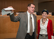 Houston ISD superintendent Dr. Terry Grier, left, recognizes Michele Pola, right, during a Central Office staff meeting, April 8, 2014.