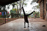 A boy does a handstand at the AFCIC residential centre in Thika, Kenya. AFCIC - Action for children in conflict, help children who have been affected by various forms conflict or crisis.