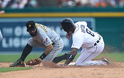 August 10, 2017 - Detroit, MI, USA - The Detroit Tigers' Justin Upton, right, slides safely into second base ahead of the tag by Pittsburgh Pirates infielder Sean Rodriguez in the third inning on Thursday, Aug. 10, 2017, at Comerica Park in Detroit. The Pirates won, 7-5. (Credit Image: © Kirthmon F. Dozier/TNS via ZUMA Wire)