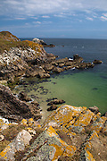 View of the cliffs on the south, unsheltered side of the Great Saltee, the larger of the Saltee Islands, off the coast of Co. Wexford, Ireland. In the background is the Makestone, which has a gannet colony.