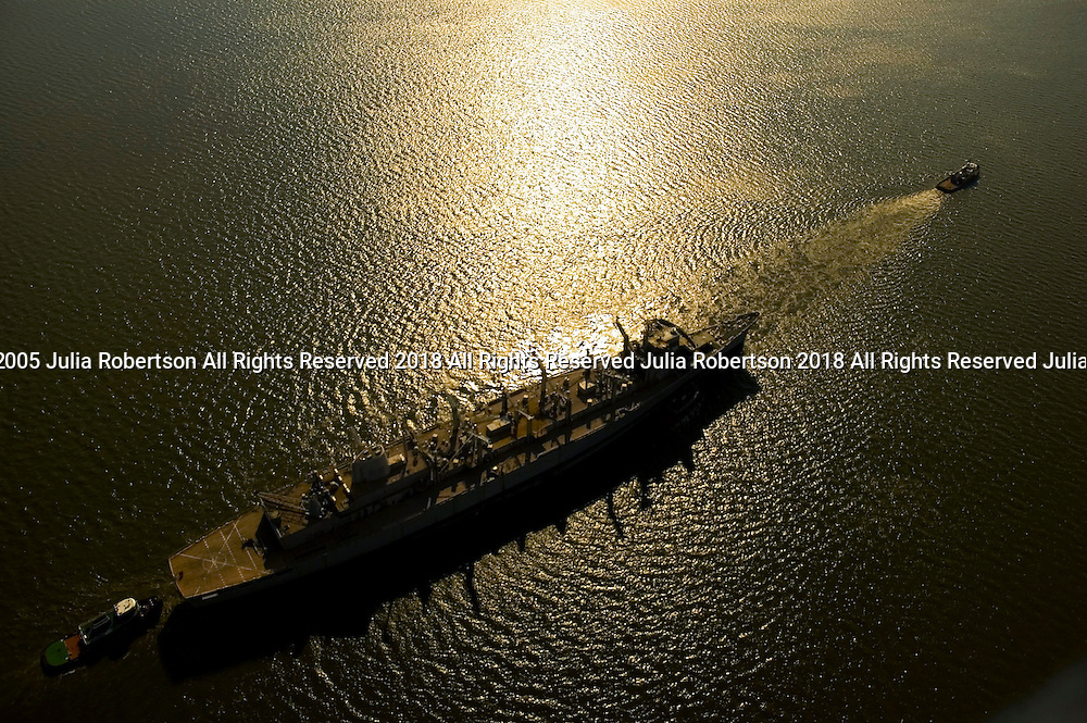 Aerial view of the USS SEATTLE being pulled down the Delaware river, a Sacramento-class fast combat support ship,