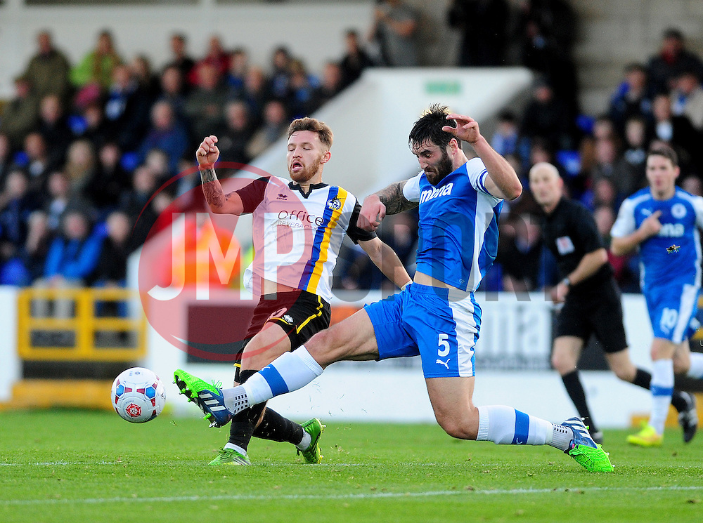 Bristol Rovers' Matty Taylor is challenged by Chester's Matty Brown - Photo mandatory by-line: Neil Brookman/JMP - Mobile: 07966 386802 - 22/11/2014 - Sport - Football - Chester - Deva Stadium - Chester v Bristol Rovers - Vanarama Football Conference