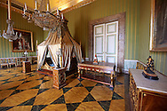"""""""The bedroom of Joachim Murat""""  is decorated in the Empire style and comes from the Royal Palace of Portici, the favourite palace of  Joachim Murat and Caroline Bonaparte. The bed is mahogany designed by French Architedt Leconte.  On the wall is a portrait of Julia Clary and her daughters.  The Bourbon Kings of Naples Royal Palace of Caserta, Italy. .<br /> <br /> Visit our ITALY HISTORIC PLACES PHOTO COLLECTION for more   photos of Italy to download or buy as prints https://funkystock.photoshelter.com/gallery-collection/2b-Pictures-Images-of-Italy-Photos-of-Italian-Historic-Landmark-Sites/C0000qxA2zGFjd_k<br /> <br /> <br /> Visit our EARLY MODERN ERA HISTORICAL PLACES PHOTO COLLECTIONS for more photos to buy as wall art prints https://funkystock.photoshelter.com/gallery-collection/Modern-Era-Historic-Places-Art-Artefact-Antiquities-Picture-Images-of/C00002pOjgcLacqI"""