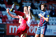 Luke Prosser of Stevenage kicks the ball trying to defend the Bradford City goal mouth during the EFL Sky Bet League 2 match between Stevenage and Bradford City at the Lamex Stadium, Stevenage, England on 5 April 2021.