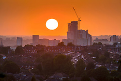 "© Licensed to London News Pictures. 17/09/2020. Leeds UK. The sun sets over the City of Leeds in West Yorkshire last night as the city is poised to be added to the list of areas in England facing stringent coronavirus restrictions. The need for new controls in the West Yorkshire city was discussed at a ""gold command"" meeting chaired by the health secretary, Matt Hancock, just hours after it emerged that the north-east would be placed under new restrictions. Photo credit: Andrew McCaren/LNP"