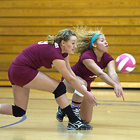 101614      Cayla Nimmo<br /> <br /> Ramah Mustangs Fate Clawson (9) and Charlie Daniels (2) dive for the ball during the game against Navajo Pine Warriors held in Pine Thursday evening.