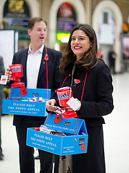 © London News Pictures. 06/11/2013 . London, UK.  Deputy Prime Minister NICK CLEGG and his wife MIRIAM GONZALEZ DURANTEZ selling poppies at Charring Cross Station in central London to raise money for the Poppy Appeal ahead of remembrance sunday this weekend.  Photo credit : Ben Cawthra/LNP