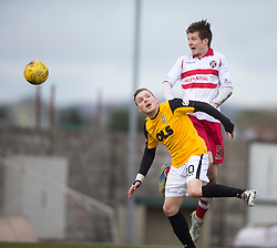 Stirling Albion's Ross Smith over East Fife's Jamie Insall. <br /> Half time : East Fife 0 v 0 Stirling Albion, Scottish Football League Division Two game played atBayview Stadium, 20/2/2106.
