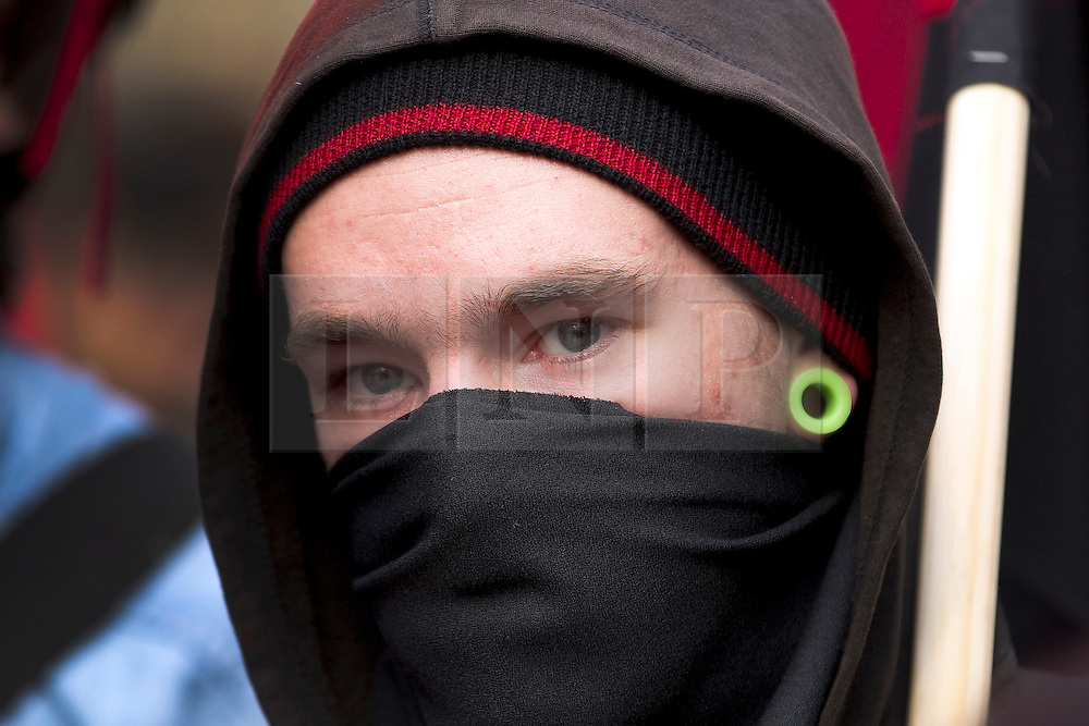 """© under license to London News Pictures. 25/03/2011: Masked protesters on the streets of London during a day of protests across the city. The Home Secretary, Theresa May, is looking at giving police extra powers to force protesters to remove face coverings. Credit should read """"Joel Goodman/London News Pictures""""."""