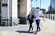 A couple is seen wearing face mask during the coronavirus lockdown in London, Tuesday, May 5, 2020. Whilst a few European countries relax the COVID-19 lockdown, Britain still remains under lockdown without an exit strategy yet. (Photo/Vudi Xhymshiti)