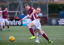 Stenhousemuir's Ruaridh Donaldson and Airdrie's Scott Stewart. half time : Stenhousemuir 0 v 0 Airdrie, Scottish Football League Division One played 26/1/2019 at Ochilview Park.