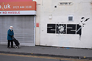 On the last day before the national coronavirus lockdown three, a hopeful piece of graffiti street art has appeared in Kings Heath offering hope that the shackles of the Covid-19 virus will be broken in 2021, on 5th January 2021 in Birmingham, United Kingdom. Following the recent surge in cases including the new variant of Covid-19, this nationwide lockdown, which is an effective Tier Five, came into operation today, with all citizens to follow the message to stay at home, protect the NHS and save lives.