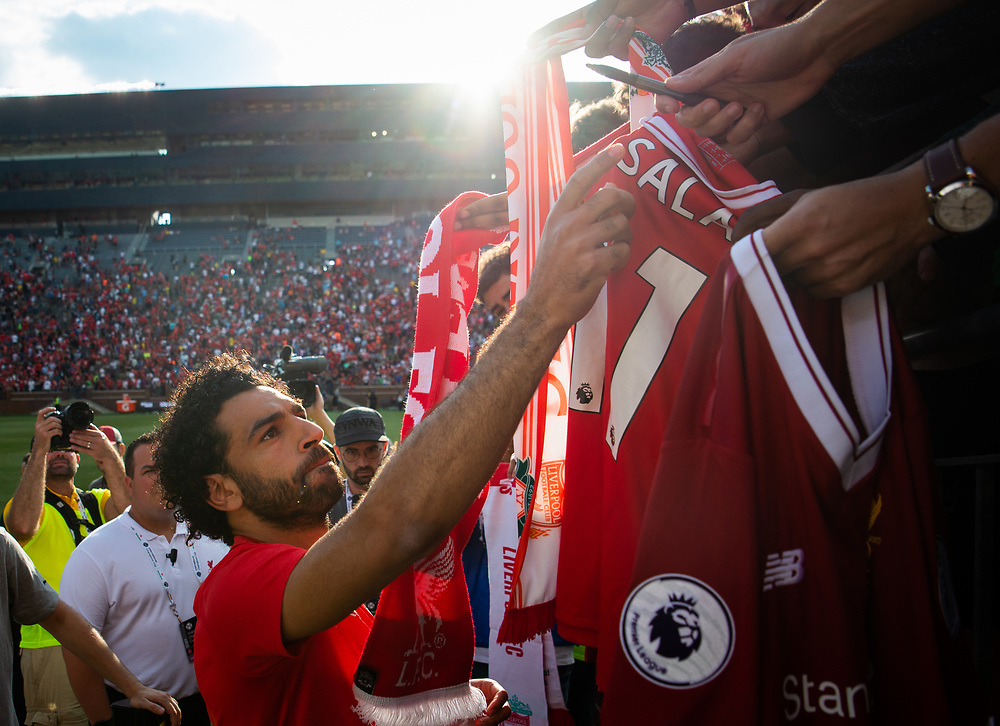 Liverpool FC striker Mohamed Salah signs jerseys for fans after his side beat Manchester United 4-1 at Michigan Stadium in Ann Arbor, Mich. on July 28, 2018.