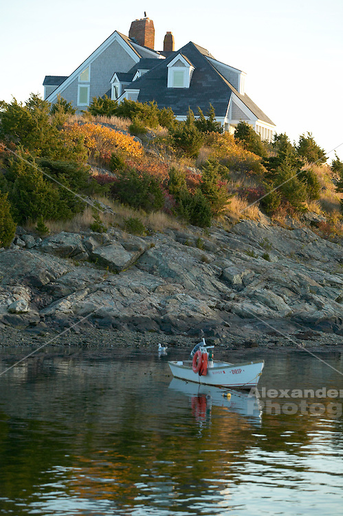 USA, Newport, RI - Fisherman's boat named 'Drip'  rests at its' mooring on Ocean Drive, fall color on the shore.
