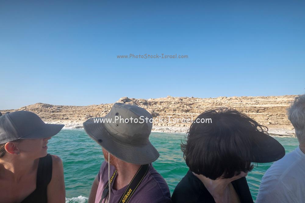 Tourist enjoy a boat trip on the Dead Sea, Israel