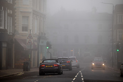 Licensed to London News Pictures. 09/10/2021. London, UK. Dense fog in Wimbledon Village south-west London this morning as the Met Office issue yellow weather warnings for fog patches in London and the South East, leading to difficult driving conditions and disruption to travel. Photo credit: Alex Lentati/LNP