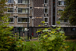 © Licensed to London News Pictures . 11/10/2018. Salford , UK . GV of Plane Court with temporary cladding stripped back to the original brick-work in places . Recently installed cladding at several council-owned tower blocks in Salford has been identified as having similar dangerous properties to that which was installed on the Grenfell Tower in London . Residents have been waiting months for clarification on what action will be taken to make their homes safe . Photo credit : Joel Goodman/LNP