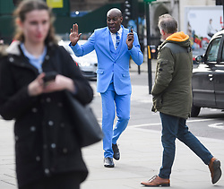 © Licensed to London News Pictures. 13/12/2018. London, UK. .Former WBC heavyweight boxing champion, FRANK BRUNO MBE is seen talking on his phone while walking through Westminster wearing a bright blue suit. Photo credit: London News Pictures Ltd