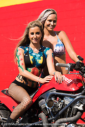 Jenny Giddens and Harli Ingwersen at the drag strip Saturday afternoon during the Smokeout. Rockingham, NC. USA. June 20, 2015.  Photography ©2015 Michael Lichter.
