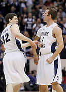BYU guard Jimmer Fredette (32) reacts as his teammate Jackson Emery (4) celebrates late in the second half of an NCAA college basketball game against Utah in Provo, Utah, Saturday, Feb. 12, 2011. BYU defeated Utah 72-59. (AP Photo/Colin E Braley)