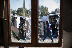 """© Licensed to London News Pictures . 23/10/2016 . Calais , France . The Calais migrant camp known as """" The Jungle """" , in Northern France , on the final day before the eviction and destruction of the camp . Photo credit: Joel Goodman/LNP"""