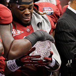 Jan 9, 2012; New Orleans, LA, USA; Alabama Crimson Tide running back Trent Richardson (3) holds the Coaches Trophy after defeating the LSU Tigers 21-0 in the 2012 BCS National Championship game at the Mercedes-Benz Superdome.  Mandatory Credit: Derick E. Hingle-US PRESSWIRE