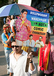 © Licensed to London News Pictures. 25/11/2012. New Delhi, India. A man holds a banner calling on the Bollywood film industry to change its depiction of gay characters in films.  Homosexuals, bisexuals and transgenders take part in the Gay Pride Parade in New Delhi on 25 November 2012. Legalising homosexuality has had little impact on the deeply entrenched homophobia in India, where thousands of gays still face discrimination and a lack of basic rights. Photo credit : Andrew Ash/LNP