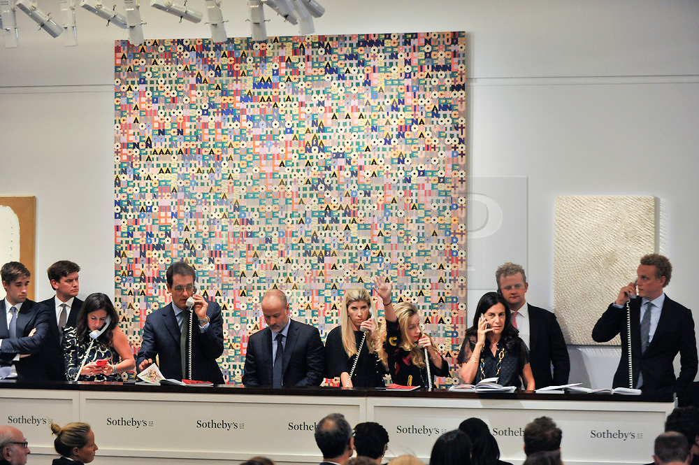 © Licensed to London News Pictures. 05/10/2017. London, UK.  'Addizione', 1982, by Alighiero Boetti sold for a hammer price of GBP2,000k (Est. GBP1,700-2,500k) at the Italian and Contemporary Art evening auction at Sotheby's, New Bond Street, coinciding with the opening of the London's Frieze Art Fair. Photo credit : Stephen Chung/LNP
