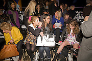 FRONT ROW INCLUDES; BLAKE WOOD; PEACHES GELDOF; ELIZABETH JAGGER;  ' Colour Me Happy' House of Holland fashion show , Quaglinos. Bury St. London. 24 February 2009.