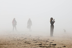 © Licensed to London News Pictures.  20/04/2021. Margate, UK. Members of the public enjoy sunny and foggy afternoon in Margate, east Kent. As a mini heatwave is forecast to hit parts of UK this week with high temperatures reaching 22 celsius. Photo credit: Marcin Nowak/LNP