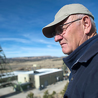 Joe Lister looks out over the Mount Taylor Mine from a view on the back bluffs Thursday. Lister is the Mine Manager and spent his younger years working as a miner.