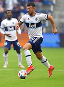 May 16, 2021 - Kansas City, KS, United States:  Vancouver Whitecaps forward Lucas Cavallini (9) brings the ball downfield.   Sporting KC beat the Vancouver Whitecaps FC 3-0 in a Major League Soccer game. <br /> Photo by Tim Vizer/Polaris
