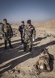 November 19, 2016 - Hammam Al-Alil, Nineveh Governorate, Iraq - Specialists of the Iraqi Police are investigating the mass graves at Hammam al-Alil. More than 300 former Iraqi policemen were executed south of Mosul three weeks ago. (Credit Image: © Berci Feher via ZUMA Wire)