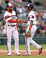 CHICAGO - SEPTEMBER 29:  Tim Anderson #7 of the Chicago White Sox is greeted by Yoan Mondaca #10 while leaving the game against the Detroit Tigers after clinching the American League batting title on September 29, 2019 at Guaranteed Rate Field in Chicago, Illinois.  (Photo by Ron Vesely)  Subject:   Tim Anderson; Yoan Moncada