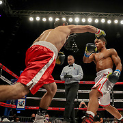 KISSIMMEE, FL - MARCH 05: Jonathan Conde punches at Floyd Schofield during the Boxeo Telemundo All Star Boxing event at Osceola Heritage Park on March 5, 2021 in Kissimmee, Florida. (Photo by Alex Menendez/Getty Images) *** Local Caption *** Floyd Schofield; Jonathan Conde