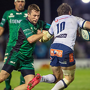 GALWAY, IRELAND:  October 01:   Johan Goosen #10 of Vodacom Bulls is tackled by Jack Carty #10 of Connacht during the Connacht V Vodacom Bulls, United Rugby Championship match at The Sportsground on October 1st, 2021 in Galway, Ireland. (Photo by Tim Clayton/Corbis via Getty Images)