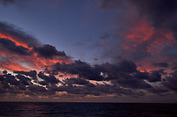 Colorful Dawn clouds over the Pacific Ocean from the deck of the MV World Odyssey. Image 5 of 6 taken with a  Fuji X-T1 camera and 23 mm f/1.4 lens (ISO 200, 23 mm, f/5.6, 1/60 sec). Raw images processed with Capture One Pro.