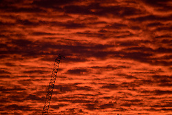 © Licensed to London News Pictures. 12/02/2021. London, UK. A deep red sunrise over the city of London, on another morning of sub zero temperatures in the capital. Photo credit: Ben Cawthra/LNP