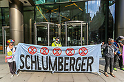 Members of Extinction Rebellion Youth Cambridge unfurled a banner saying: 'Planet Killer SCHLUMBERGER' as they blocked the road outside Baringa Partners building in London on Thursday, Sept 10, 2020 - in an attempt to highlight the involvement of Schlumberger Limited in what they call 'ecocide'. Schlumberger is an oilfield services company working in more than 120 countries and has four principal executive offices located in Paris, Houston, London, and The Hague. An article at the Guardian suggests that it's ubiquitous in fossil fuel operations across the world, has more staff than Google, turns over more than Goldman Sachs, and is worth more than McDonald's – yet you won't have heard of it. XR Youth of Cambridge said that the British government gave Schlumberger a no-strings-attached £150 million bailout loan as it was laying off a fifth of its global workforce. Another activist added: 'Schlumberger is hiding in plain sight here in Westminster. Every day, hundreds of people walk past this building with no idea that they're on the doorstep of a climate crime scene.'<br /> Environmental nonviolent activists group Extinction Rebellion enters its 10th and final day of continuous ten days protests to disrupt political institutions throughout peaceful actions swarming central London into a standoff, demanding that central government obeys and delivers Climate Emergency bill. (VXP Photo/ Vudi Xhymshiti)