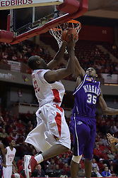 12 December 2009: Kashief Edwards defends a shot by Dinma Odiakosa. The Purple Eagles of Niagara defeat the Redbirds of Illinois State 76-68 on Doug Collins Court inside Redbird Arena in Normal Illinois.