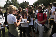 A teacher addresses a school group of Spanish students during a field trip to Colchester, Essex, England